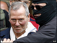 Bernardo Provenzano is taken to a police building in Palermo, southern Italy