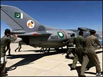 Pakistan Air Force crews push Chinese-made F-6 aircraft at Smungli Air Base near Quetta