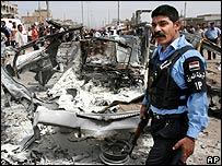 Policeman at site of minibus blast in Baghdad