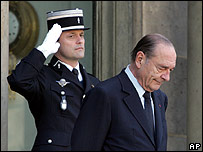 Policeman salutes as Jacques Chirac passes on the Elysee Palace steps