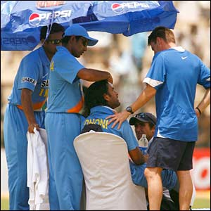 India players take a drinks break under sun umbrellas