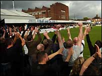 FC United supporters cheer on their team