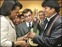 US Secretary of State Condoleezza Rice, left, receives a charango (Bolivian ukulele) as a gift from Bolivian President Evo Morales