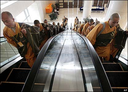 Buddhist monks arrive at the conference centre
