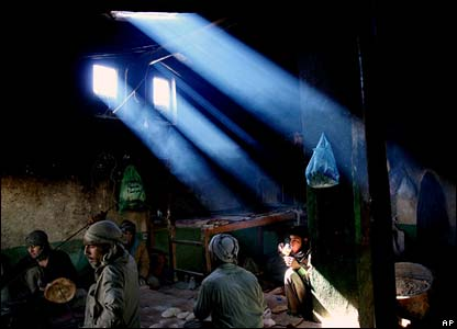 Shafts of light illuminate a bakery in the Afghan capital, Kabul