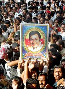 Fans with Rajkumar's poster gather at his house to mourn his death