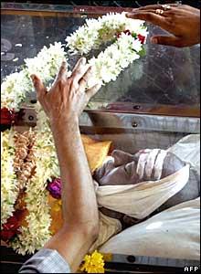 Mourners put flowers on actor Rajkumar's casket