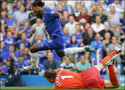 Chelsea's Didier Drogba leaps over Arsenal goalkeeper Jens Lehman at Stamford Bridge in August