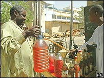 People buying black-market petrol in N'Djamena, the Chadian capital