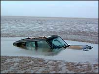 Car sunk in quicksand at Brean in Somerset