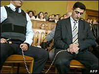 Ramil Safarov looks at his watch as sentence is pronounced