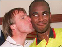 Dave Bassett kisses Tony Agana