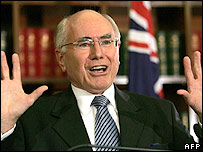 Australian Prime Minister John Howard gestures during a press conference in Sydney, 13 April 2006, after appearing before the Cole Inquiry