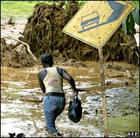 Woman wades through the mud