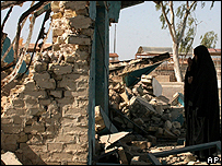 Woman at a destroyed Shia shrine near Baquba