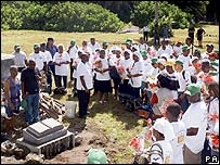 Returning Chagossians dedicate a memorial stone to mark their visit