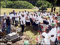 Returning Chagossians dedicate a memorial stone to mark their visit