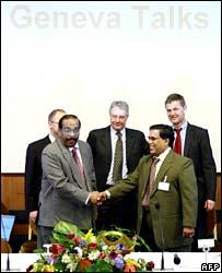 Rebel negotiator Anton Balasingham (left) and the government's Nimal Siripala de Silva shake hands at Geneva talks in February