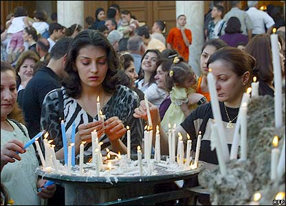 Iraqi Catholic women light candles at St Marie's church in Baghdad