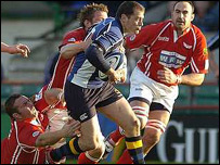 Felipe Contepomi is tackled by Craig Dunlea and Dafydd Jones