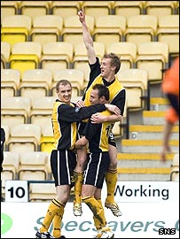 Sam Morrow celebrates his early strike for Livingston