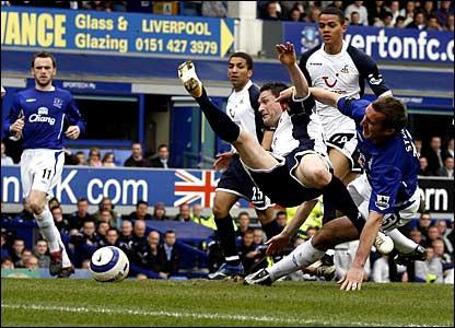 Everton's Alan Stubbs fouls Robbie Keane