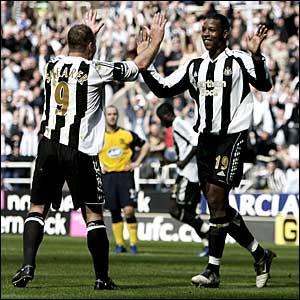 Alan Shearer and Titus Bramble celebrate a Newcastle goal