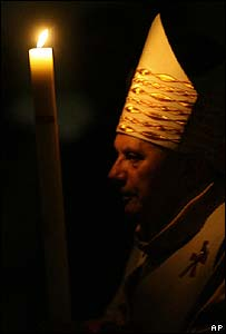 Pope Benedict XVI holds a candle during an Easter vigil Mass