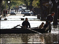 Residents use a canoe to cross a flooded street in Nikopol, Bulgaria