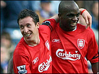 Liverpool goalscorer Robbie Fowler celebrates with Momo Sissoko