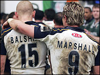 Iain Balshaw (L) and Justin Marshall leave the field after the loss to London Irish