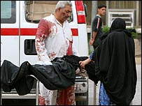 An injured Iraqi girl is taken away from the scene of a bomb in Iraq