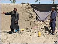 Afghans show off damage they say was caused by coalition strikes