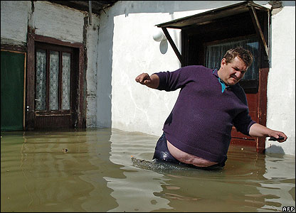 A man struggles in the Sava River flood waters in Belgrade, Serbia