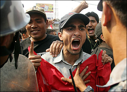 A protester shouts at police during a rally in the Nepalese capital, Kathmandu