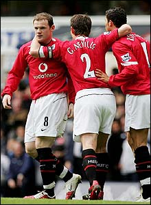 Rooney is congratulated by his team-mates