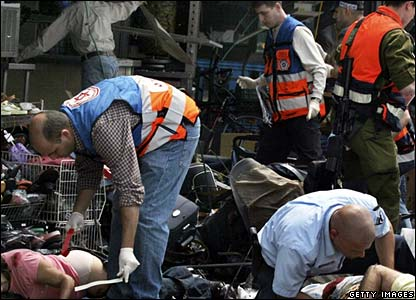 Emergency workers at the scene of the suicide bombing