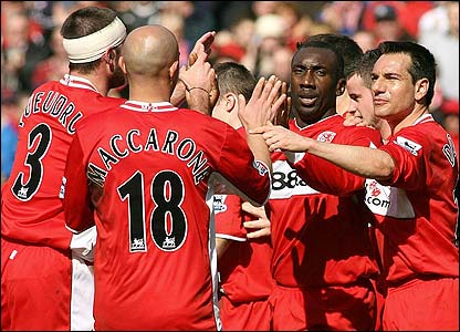 Jimmy-Floyd Hasselbaink is mobbed by his team-mates