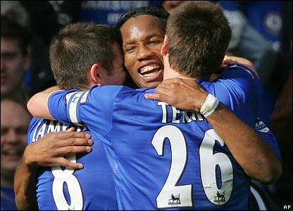 Didier Drogba is congratulated by Frank Lampard and John Terry
