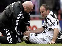 Alan Shearer receives treatment on his injury