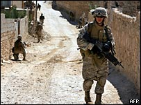 Marines from the 3rd Battalion, 3rd Marine Regiment conducting a foot patrol through the streets of Haditha