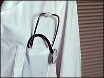 Stethoscope in doctor's coat pocket