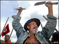 A member of the Landless Workers Movement blocks a road in northeast Brazil as part of a protest to commemorate the killings