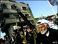 An elderly Palestinian man takes part in a rally in the Khan Yunis refugee camp in the southern Gaza Strip on 17 April 2006 against the European Union and US's decision to suspend aid.