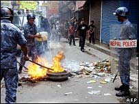 Police remove burning tyres in Nepal