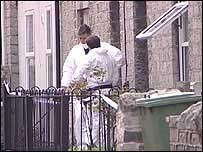 Forensics officers at the house in Street