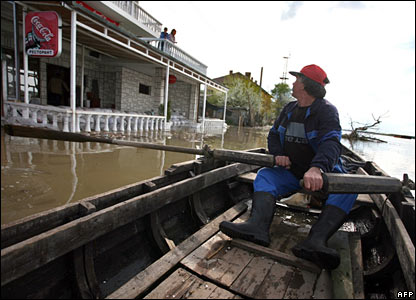 In the town of Lom, Bulgaria, a man rows to his home on the flooded streets.