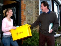 David Cameron delivers a recycling box to Charlotte Sheehan, 19