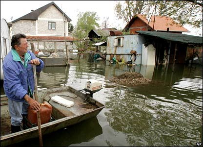 A man rows through the street flooded by the Danube, in the village of Oresac, southeast of Belgrade.