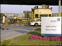 Security men guard the entrance of the oil-processing plant of the Saudi state oil giant Aramco in Abqaiq